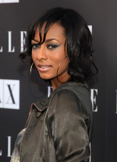 Keri Hilson Medium Curls Singer Keri Hilson paired her romper with a casually cool wavy shoulder length haircut.