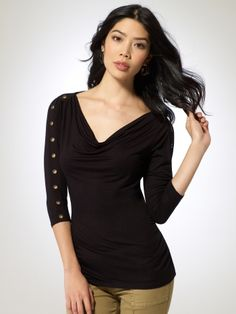 3/4 length sleeve top with drape neck. Grommet detailed sleeves. Ruching at sides.94% spandex, 6% spandexImportHand wash
