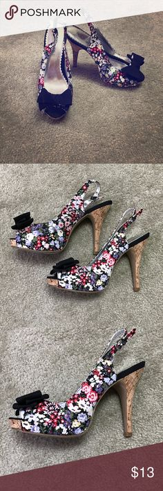 Floral Open-Toed Heels These heels are so cute! Perfect for the spring/summer! They have black bows on the toe opening and the heel is a cork-like material. Heel is about 5in Shoes Heels