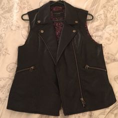 Leather vest Awesome black leather vest. Love this piece so much. Has real pockets and cool print on the inside. Never worn. Sanctuary Jackets & Coats Vests