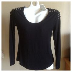 Studded Shoulders. This black top with gray studs on the shoulders by Joan vass  will dress up any outfit!  Pair it with Jeans or leggings!  Silky soft fabric of Rayon with Spandex is machine wash!  Size S. It's a little big on me. joan vass Tops