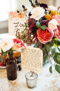 Love quotes were scattered about on the tables at this wedding