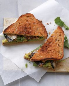 Spread avocado on toasted seven-grain bread, layer on watercress and canned sardines, and sprinkle with fresh lemon juice and sea salt.