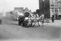 New York, NY: Horse-drawn fire engine at 72nd Street and Broadway, New York City, racing to a fire. Photograph, ca. 1910. Horse-Drawn Fire Engine Going Down Broadway