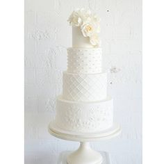 """White on white wedding cake - classic and modern """