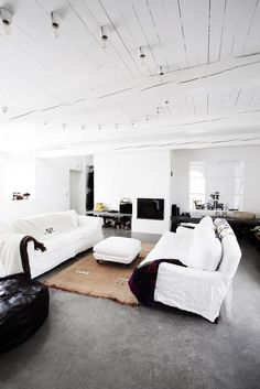 rustic white cabin living room with porcelain light socket fixtures on the ceiling