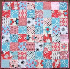 Hmmm. Maybe I could do simple squares for Isla's quilt like this, but in teal/turquoise/aqua and orange/red/persimmon fabrics.