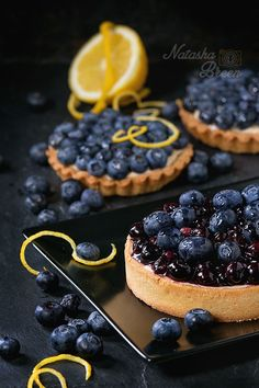 Tart with Blueberries - Lemon Tart and tartlets with fresh and cooked…