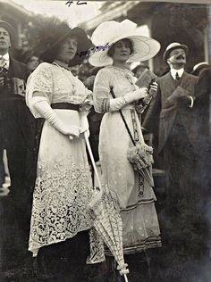 c. 1914. Note the lace and large hats.