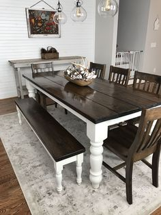 I like the darker stain Custom built, solid wood Modern Farmhouse Dining Furniture. L x W x H Baluster Table with a traditional tabletop stained Dark Walnut with an Ivory painted base. Pictured with a Dianne Bench and Henry Dining Chairs. Farmhouse Dining Room Table, Dining Room Table Decor, Dining Room Design, Dining Room Furniture, Diy Table, Room Chairs, Farmhouse Furniture, Furniture Ideas, Kitchen Table With Bench