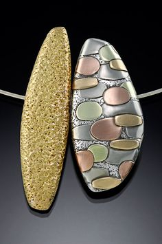 """Pam Caidin, """"The synergy that comes from the juxtaposition of contrasting shape, color and texture intrigues me. The forms are quiet to allow pattern and color to have weight. My intent is to create sculptural jewelry that is elegant and unpretentious. With the use of a rolling mill, textured fine silver is inlayed with successive layers of rose, yellow & green 14K gold, nickel silver, then handformed into hollow pillows. Patterned pillows are combined with pillows of a single color. . ."""""""