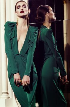 Deep cleavage on beautiful green gown