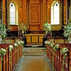 Image result for make flower arrangements for seat ends in church for wedding