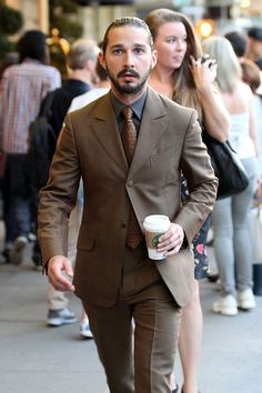 #Lawless star Shia LaBeouf looks dapper in a suit as he sips on a Starbucks while leaving his hotel in NYC