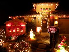 Life-Size Gingerbread House  This Arizona home's exterior is covered with candy decorations to resemble a gingerbread house. Lemon wedges, gumballs and wafer cookies surround the entrance to the home.