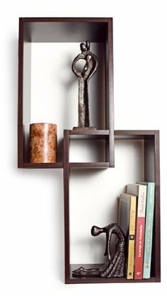 Mount Intersecting Wall Shelf by Danya B. $41.89. Decorative and funcional. Walnut color to fit any decor. Made of MDF & laminate.. Easy to hang. All hardware included. Dimensions: 26x14x6 inches. XF11034 Features: -Material: MDF and laminate.-Vertically or horizontally.-Hidden perforations secure to nails or screws.-Just wipe clean.-Contemporary design. Color/Finish: -Walnut finish. Assembly Instructions: -Minor assembly is required.