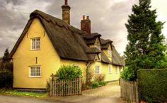 A cheerful little gated cottage, buttery yellow and full of bliss, in lovely Cambridgeshire, England.  (cottage image by mmayson on flickr)