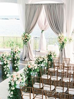 Ceremony wedding canopy and flowers at Palais Royale Tent by Rachel A. Clingen. Photo by @andrewmarkca