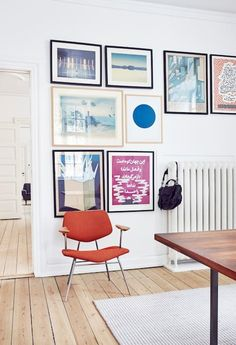 Colorful and pretty gallery wall featuring different artworks and pictures in black and brown colors.
