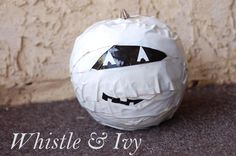 Duck Tape Mummy Jack-O-Lantern- A little bit spooky, a little bit adorable. This no-carve pumpkin craft is fun for kids and adults.
