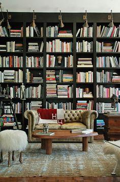 Library, bookshelves, books, classic leather sofa, surrealist pouf - Tommy Clements via Architectural Digest. (via Canoe Design)