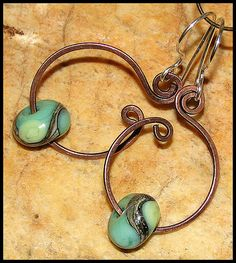 Swirls and handmade beads. I like that they used copper on silver ear wires… Copper Jewelry, Wire Jewelry, Jewelry Crafts, Jewelry Art, Beaded Jewelry, Jewelry Design, Jewellery, Copper Wire, Jewelry Ideas
