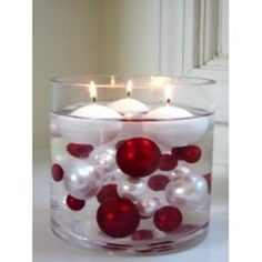 A vase full of water, cheap Christmas ornaments, and a package of floating candles are all you need for a fabulous centerpiece.