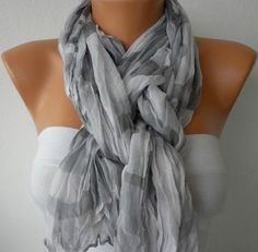 quartered fold scarf  -fold in half  -wrap around neck  -pull one strand through loop  -twist loop  -pull second strand through loop  -adjust as needed