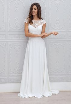 Ivory embroidered chiffon vintage ball gown is crafted and just breathtaking! Illusion neckline bodice with cap sleeves features delicate lace embroidery, A-line skirt flows to floor elegantly, keyhole back with eyelash detail. Bow sash on back with lace streamer defines the waist.