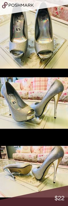 Shoes Brand new, size 6.5, 6 inch heels, silver glitter. Shoes Heels