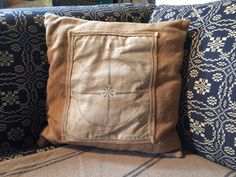 """A great primitive pillow cover made from woven tan fabric. Compass printed on distressed muslin, stitched onto pillow front and framed with woven edging. Envelope opening in back to fit a 12"""" square pillow form. $19.95 Cdn plus shipping."""