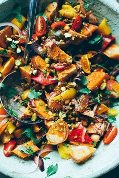 Vegan sweet potato sunshine salad with moroccan-inspired spices, date vinaigrette, and pistachios. A healthy crowd pleaser!