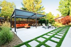 Exterior - Modern And Minimalist Concrete Patio With Iron Pergola Rattan Sofa Grey Benches Grey Chairs And The Long Table: Artistic Pergola ...