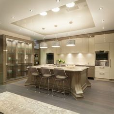 White matt stretch ceiling with a grey high gloss center piece above a kitchen island at the Luxury Home&Design Show in Vancouver