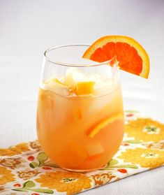 White sangria with pear: 1 bottle dry white wine 1-1/4 cups pear juice 1/4 cup brandy 1 cup chopped canned pears 1 cup chopped canned peaches 8 orange slices, halved