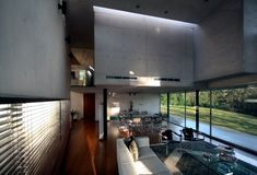 The architectural firm RP Arquitectos designed Briones House - a modern concrete house in Mexico. The house is located in a wooded area in Xalapa and has two Open House Plans, Bungalow House Plans, Contemporary Architecture, Interior Architecture, Home Interior Design, Interior Decorating, High Ceiling Living Room, Minimalist Home, Beautiful Interiors
