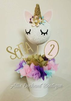 This Centerpiece is so amazing that I am completely in love! I used a round foam for head and all flowers and all decorations are created and made by me. The head measures 6 inches in diameter the whole centerpiece measures 19 inches tall . I have options to buy it you can get