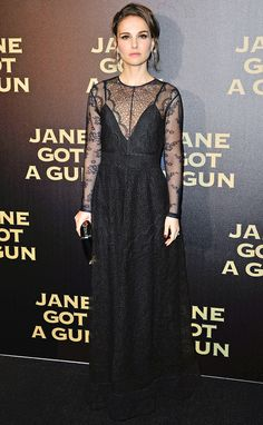NATALIE PORTMAN in a black lacy Dior dress with long sheer sleeves, dazzling diamond Cartier earrings and a box clutch at the Jane Got a Gun premiere in Paris.