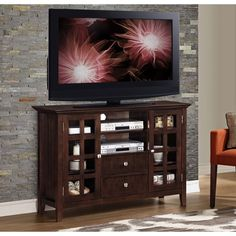$409  Solid wood.  53W 16.5D 34.75H  WYNDENHALL Normandy Collection Tobacco Brown Tall TV Media Stand