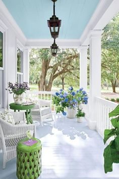"I love the ""Haint Blue"" painted porch cieling. A Charming Southern Cottage – Blue and White Home White Cottage, Cottage Style, Cottage Porch, House Porch, Porche Frontal, Veranda Design, Farmhouse Front Porches, Southern Front Porches, Painted Front Porches"