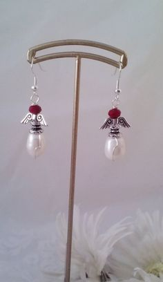 Need a gift for the Holidays?  New  Freshwater Pearl & Crystal Angel Earrings  by SkullMoto, $4.00