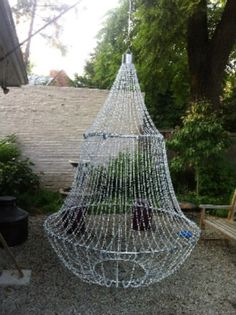 This could be great inspiration for a Phantom of the Opera party!!!  Prop Showcase: Chandelier  could make some using extra soaker hose from hoop skirt