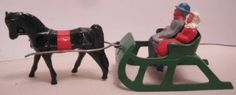 Old-Lead-Christmas-Couple-in-Horse-Drawn-Sleigh-for-Skater-Skier-Village-Set