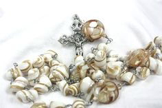 Natural Shell and composite Shell Rosary. Love the pearly whits and subtle browns here. #rosaries #MichiganMade #religion #HandmadeRosary #Handmade