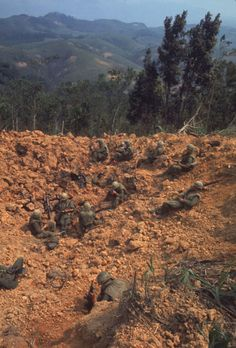 Stranded Marines on a bombed-out hillside, awaiting rescue supplies during Operation Pegasus/April 1968