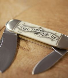 """""""Hard Times Made Us"""" scrimshaw pocket knife....so gorgeous, and needed in a decent leather purse :)"""