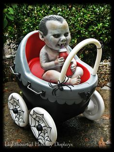 Repainted toy baby stroller into a whimsical Halloween prop.