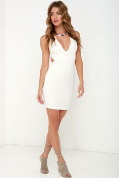 You don't have to tell us twice! The Like This and Like That Ivory Bodycon Dress is the slinky, sexy number we've been looking for! Super stretchy, ribbed knit fabric (lined in even softer jersey knit) shapes a V neckline with princess seams and shoulder straps that crisscross over an open back. Bodycon skirt has a short and flirty hem, assuring that this number will be a memorable one! Hidden back zipper.