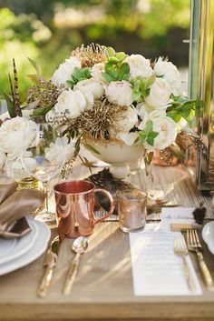 Copper and burnished tones compliment the wooden details that this trend focuses on. Source: jami d photography #westerntheme #tablescape #copper
