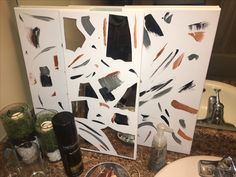 DIY wall canvas. Items needed; Canvas (these were 6 for $15 at Michaels), acrylic paint and foam brushes (your choosing), mirror ($1 at Dollar Tree), Hammer (Smash that mirror), Hot glue gun (to seal glass pieces to canvas).